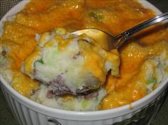 Rumbledethumps from Food.com: Similar to Colcannon, this is a Scottish dish. It can be made well in advance and refrigerated. Bring to room temperature before baking. It's very easy and inexpensive to make. Even my husband, who hates cabbage, loves it in this dish.