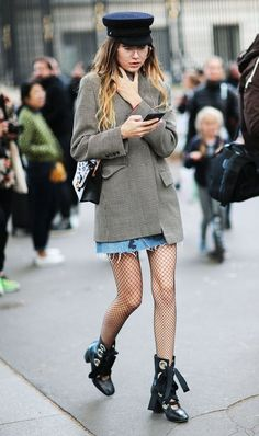 fishnet and boots with denim skirt