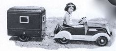 Pedal car with camp trailer.