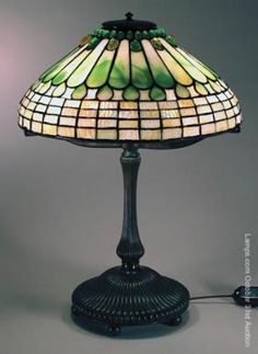 29: Tiffany Studios Leaded Glass Lamp Jewel Feather : Lot 29 sold for $ 14,000
