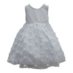 For your uptown girl. Effortless elegance is the name of this dress. The sleeveless white dress features a glitter neckline and waist leading to a chevron style floral embroidered skirt. Ribbon ties for adjustable waist.