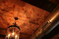 AcoustiArt printed acoustical panels were branded with Casa Del Barco's logo and installed on the ceiling - A beautiful way to reduce noise in a restaurant!