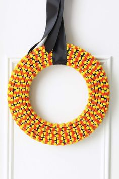 Candy Corn Wreath Tutorial: Your favorite Halloween candy is good for so much more than just a snack.