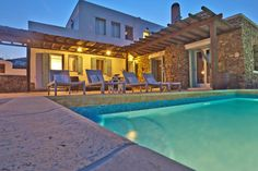 A set of photos of the Panormos Bay sea view 5 Bedroom Villa with Private Pool from Mykonos Panormos Villas.
