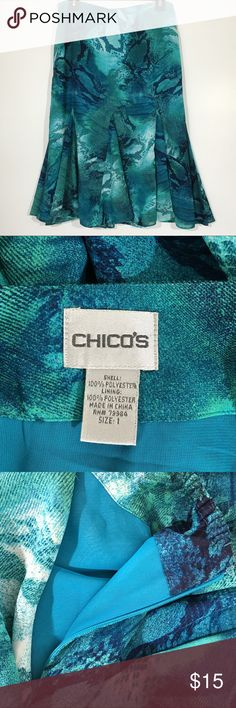 """Chico's Flared Skirt Size 1 Cute skirt is 100% polyester and fully lined. Measures 15"""" across at waist laying flat and about 26"""" long. Triangle insets give the bottom of the  skirt a flare. Back of waist has elastic. Side zip and hook and eye. This is a Chico's size 2, which is a size 8/10. Please ask questions and check out bundling to save. Chico's Skirts"""