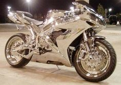 Chrome Silver Bike! I wonder each time I see a pic of a chrome car or bike, would it not blind others if the wrong reflection hits? If possible, once it happens, this will be illegal I suspect.