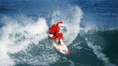 Funny Santa Surfing Pictures HD Wallpaper