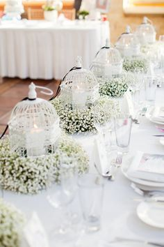 Baby's breath and birdcages with candles as whimsical wedding table decor - white wedding decor inspiration - unique wedding centerpiece ideas Vintage Wedding Centerpieces, White Wedding Decorations, Table Decorations, Centerpiece Ideas, Bird Cage Centerpiece, Birdcage Centerpiece Wedding, Centrepieces, Reception Decorations, All White Wedding