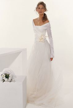 Brides: Le Spose Di Giò. Criss cross off the shoulders bolero on multi layers organza skirt. Flowers details.