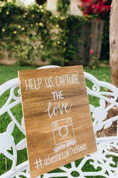 "Wedding social media sign idea - wood ""help us capture the love"" sign with couple's hashtag {Suzy Goodrick Photography}"