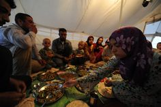 """""""In order to have peace, we need first to respect each other's cultures.""""   Um Ashraf - an Syrian refugee - and his extended family unites to break their fast inside their tent on a farm in Jordan.   Photo by: Karl Schembri/Oxfam"""