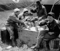 """Army Nurses take a break in the field. They are apparently enjoying a \""""C\"""" Ration meal. Normandy June-July 1944. Source: US National Archives http://med-dept.com/gallery/medical-personnel/"""