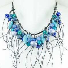 Art to wear Jewelry designed by Teresa is handmade by a select group of artisans in Minneapolis. Known for a gifted sense of color, Teresa Goodall makes art to wear jewelry, necklaces, that incorporates both fashion and timeless beauty.