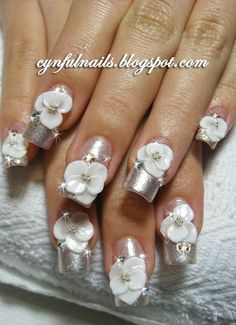 Wedding - Okay, I have to admit I actually LIKE this when usually I abhor nail art. Very Funky! and Outlandish!  Woohoo!