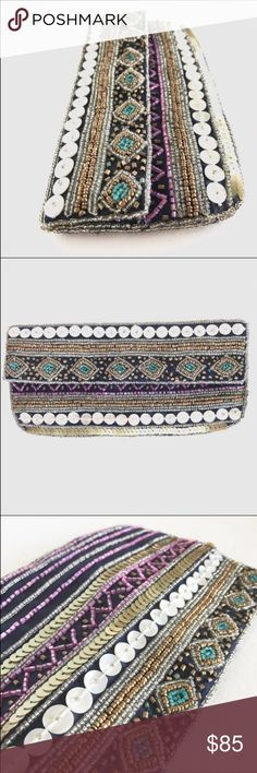 "K.C. Malhan 100% Silk Beaded Mini Clutch K.C. Malhan 100% Silk Mini Clutch, absolutely stunning with the beaded and sequined detail. EUC, smoke free home.     Length: 8""   Depth: 4"" K.C. Malhan Bags Clutches & Wristlets"