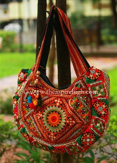 Foil Mirror Work Hand Kutch Embroidered Big Banjara Tote Bag Rs. 1062 Our price is inclusive of GST taxes Amazingly great finishing of embroidery. The bag has the comfortable strap to hang on the shoulder. The work is on both sides of the bag.  Size of the bag is  Length.-11 inches Width - 12 inches