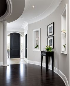 The door color, wall color, black framed chandeliers, molding around coves, heck EVERYTHING