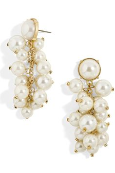 Cluster Pearl Drop Earrings | Just in time for the holidays. When it comes to jewelry, there's no need to reinvent the wheel, or the pearl, as it were. Pearls are a forever classic. They're the epitome of traditional style, an accessory that, truly, will never let you down. Pearl jewelry goes with everything, elevating attire—holiday or not—with effortless elegance. At festive parties, you won't seem Mama without her pearls, whether they're in her ears or around her neck.
