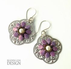 Purple Pip Bead Earrings: The little pip beads are perfect as flower petals and the glass pearl is an exquisite centerpiece to the entire design. Craft these lovely earrings for yourself or as a thoughtful homemade gift.