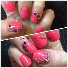 Pink acrylic nail art with glitter & rhinestones