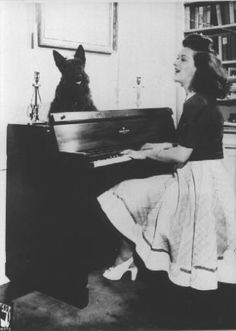 Jane at piano with dog 1940's http://www.janefroman.com/Gallery/1940s/slides/12.jane%20at%20piano%20with%20dog.html#