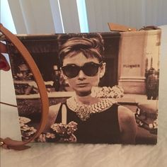 Bagghy Italian designer. Picture of Audrey Hepburn picture on it. Cross body. Super adorable. People will stop you on the street and ask where you got it :) it's a beauty. Limited edition  100% authentic. 100% leather. It can fit a iPad :) Bags Crossbody Bags