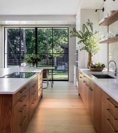 gorgeous natural woods and fresh greenery enhance this stunning modern kitchen design Mowery Marsh Architects Gorgeous kitchen decorating & design ideas, from cabinet choices to lighting, modern to classic, this gallery of kitchen images will inspire! Modern Kitchen Design, Interior Design Kitchen, Interior Decorating, Interior Ideas, Decorating Ideas, Minimal Kitchen, Decorating Kitchen, Stylish Kitchen, Modern Design