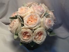 A Dreamy bouquet of white Ohara garden roses and dusty miller.  Elegant wedding in Cooperstown,  Mohican Flowers