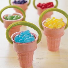 Cute Easter snack! Fill ice cream cones with jelly beans. With a small knife, carefully cut two holes into the sides of each cone. Tuck either end of an apple licorice stick into the holes to serve as an edible handle.