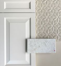 This classic Wedgewood white warm brie cabinet is paired with a polished lusso quartz with warm veins that match the Julep bloom tile in cream. The paint color is BM Manchester Tan. colors Top Kitchen Color Trends for 2019 - Color Concierge Kitchen Tops, White Kitchen Cabinets, Painting Kitchen Cabinets, Kitchen Backsplash, Tan Kitchen, White Kitchens, Closed Kitchen, Mosaic Backsplash, Kitchen Countertops