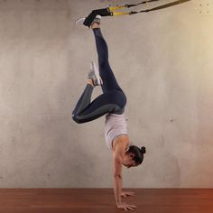 Learn the three progressions of a #TRX handstand from Yoga Expert Shauna…