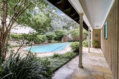 10023 Springwood Forest Dr. Swimming pool view from the front gate. Bernstein Realty, Houston Real Estate.