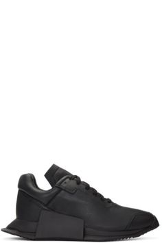 Low-top grained leather sneakers in black. Round toe. Tonal lace-up closure. Padded collar. Tonal sculpted and treaded rubber sole. Tonal stitching. Part of the Rick Owens x adidas Originals collaboration.