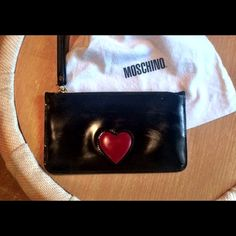 Moschino evening or whenever wrist clutch. Black patent leather wrist clutch with red heart. Excellent condition. moschino Bags