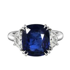 Cushion Cut Sapphire Engagement Ring with a Platinum band.