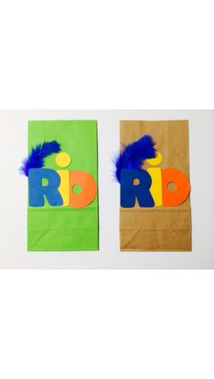 Super cute Rio goodie bags for birthday party!! Brown paper bags with Rio on the front made of blue, yellow and orange construction paper along with a blue feather!  $5 for a 10 count Need more then 10? Contact us! We will be more then happy to customize an order for you!