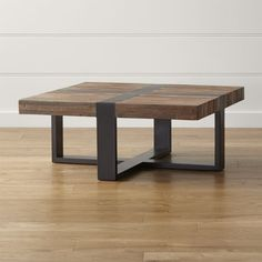 Shop Seguro Square Coffee Table.   Each reclaimed wood coffee table is unique with inherent differences in the woods that are heightened by contrasting natural and ebony finishes.  The Seguro Square Coffee Table is a Crate and Barrel exclusive.