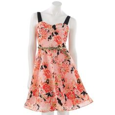 Candie's Floral Dress Floral dress with gold waist belt included. I wore this dress for my graduation a few years ago, and it has been neglected since. It no longer fits or else I would model cause it's very flattering on. my favorite part of this dress is the back! It has a corset look to it. Candie's Dresses Midi