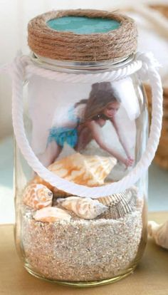 DIY Mason Jar Crafts - With a few crafty touches, you can turn ordinary jars and bottles into charming home accessories, cute gift containers, clever keepsakes, and helpful organizers. All you need is (Bottle Charms Sands) Hanging Jars, Diy Hanging Shelves, Hanging Storage, Diy Storage, Storage Ideas, Pot Mason Diy, Mason Jar Gifts, Beach Mason Jars, Beach Jar