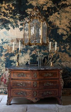 French Antiques. The mural wallpaper is amazing.