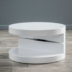 Features:  -Materials: Plywood with high gloss white finish.  -Finish: High gloss white.  -Does have rotation top.  Top Finish: -High gloss white.  Top Material: -Solid Wood.  Base Material: -Solid Wo