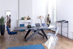 Enzo extension table and our Artella chairs with their design frame