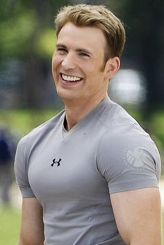 Chris Evans on set of The Winter Soldier. HIS HAIR...OH MY GOSH...and notice how the SHIELD symbol is on the sleeve of the shirt.