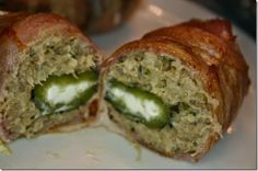 Bacon & Boudin Wrapped Jalapeno Poppers.  Too delicious for words.  (In the absence of boudin, you could also use dirty rice.)