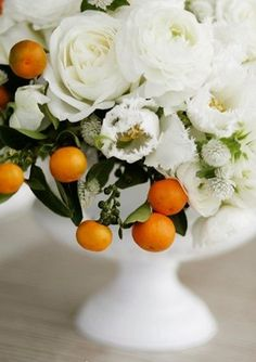 Orange/citrus wedding decor with milk glass