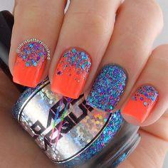 Exciting half moon glitter nail art in blue and fuchsia glitters and neon orange matte polish.