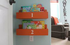 modern boy nursery orange DIY shelves, i've seen something similar using IKEA wooden spice racks.