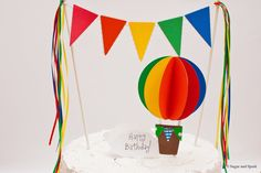 Up, Up and Away : 3D Rainbow Hot Air Balloon Cake Topper with Lacy Bunting Flag and Ribbon Accents