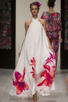 Issa. Spring 2013 Ready to Wear. Pink orchids burst against a stark white background. Issa's tropical island inspired collection will not disappoint celebrities when summer vacation comes.