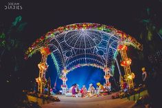Red and gold wedding setup with an open air wrought iron cut out mandap decorated with fresh flowers | weddingz.in | India's Largest Wedding Company | Mandap Design and Decorations |